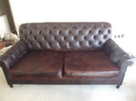 Chestfield style sofa after new cushions manufactured and the complete item recoloured in 2 tone